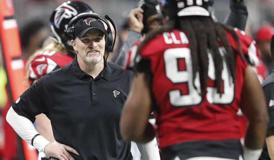 Atlanta Falcons head coach Dan Quinn speaks with Atlanta Falcons defensive end Adrian Clayborn (99) during the second half of an NFL football game, Sunday, Dec. 31, 2017, in Atlanta. (AP Photo/John Bazemore)