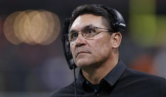 Carolina Panthers head coach Ron Rivera walks the sidelines during the second half of an NFL football game between the Atlanta Falcons and the Carolina Panthers, Sunday, Dec. 31, 2017, in Atlanta. (AP Photo/David Goldman)