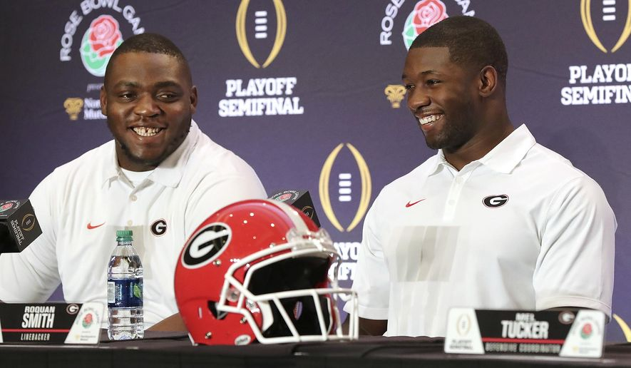 Georgia nose guard John Atkins, left, and linebacker Roquan Smith laugh during an NCAA college football news conference, Friday, Dec. 29, 2017, in Los Angeles. Oklahoma plays Georgia in the Rose Bowl on New Year's Day. (Curtis Compton/Atlanta Journal-Constitution via AP)