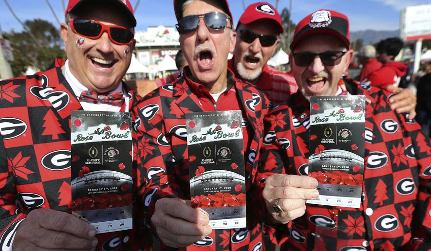 Georgia fans Keith Scott, from left, J.P. Harris, Harold Franklin and Keith Barker have their tickets in hand as they arrive for the College Football Playoff Semifinal against Oklahoma at the Rose Bowl NCAA college football game, Monday, Jan. 1, 2018, in Pasadena, Calif. (Curtis Compton/Atlanta Journal-Constitution via AP)
