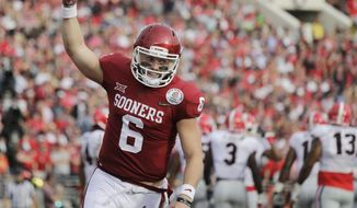 Oklahoma quarterback Baker Mayfield celebrates after running back Rodney Anderson scored a touchdown against Georgia during the first half of the Rose Bowl NCAA college football game Monday, Jan. 1, 2018, in Pasadena, Calif. (AP Photo/Jae C. Hong)