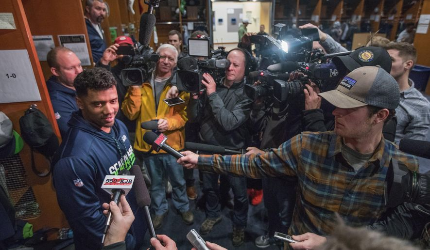 Seahawks quarterback Russell Wilson answers questions a day after the last game of the season in the Seahawks locker room as other players clean out their lockers on Monday, Jan. 1, 2018. (Steve Ringman /The Seattle Times via AP)