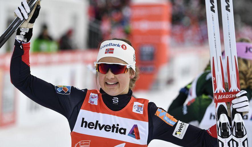 Ingvild Flugstad Oestberg of Norway celebrates after winning the women's ten kilometers pursuit cross country race at the Tour de Ski in Lenzerheide, Switzerland, Monday, Jan. 1, 2018.  (Peter Schneider/Keystone via AP)
