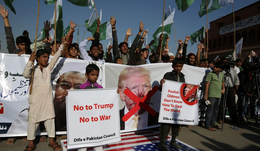 Supporters of Pakistani religious groups rally to condemn a New Year's Day tweet by President Trump in Karachi, Pakistan on Tuesday. Trump slammed Pakistan for 'lies & deceit' in a tweet that said Islamabad had played U.S. leaders for 'fools'. (Associated Press)