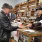 Longtime customer Doug Krentzlin (left) bought his last CD at Roadhouse Oldies from shop owner Alan Lee before the Silver Spring store closed this weekend after 43 years. (Julia Airey / The Washington Times)