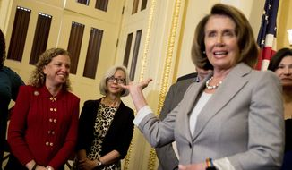 """House Minority Leader Nancy Pelosi of Calif., right, recognizes Rep. Debbie Wasserman Schultz, D-Fla., left, during a news conference on American labor on Capitol Hill in Washington, Wednesday, Nov. 1, 2017. Trump said on Twitter that the driver in Tuesday's attack """"came into our country through what is called the 'Diversity Visa Lottery Program,' a Chuck Schumer beauty""""  a reference to the Senate's Democratic leader. (AP Photo/Andrew Harnik)"""