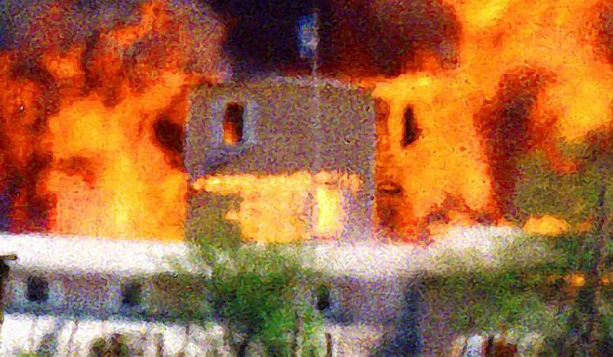 The Branch Dividian compound near Waco, Texas, burns during an FBI raid in 1993. Associated Press photo