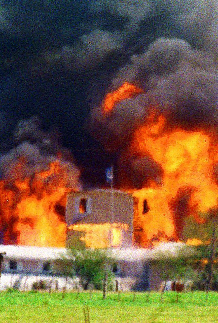 The Branch Dividian compound near Waco, Texas, burns during an FBI raid in 1993. Associated Press photo