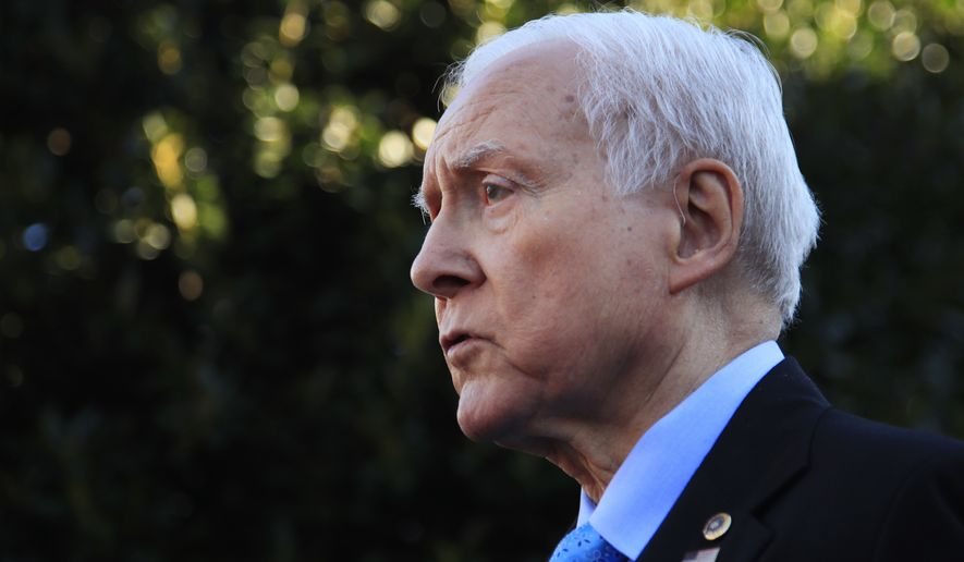 Senate Finance Committee Chairman Orrin Hatch, R-Utah, speaks to reporters following a meeting with President Donald Trump at the White House in Washington, in this Nov. 27, 2917, file photo. Hatch says he is retiring after four decades in Senate. (AP Photo/Manuel Balce Ceneta, File)