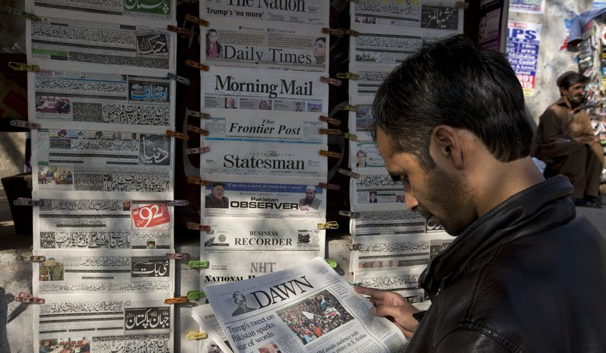 """A man reads a local newspaper carrying news about a tweet by U.S. President Donald Trump at a news stand in Islamabad, Pakistan, Tuesday, Jan. 2, 2018. Trump slammed Pakistan for """"lies & deceit"""" in a New Year's Day tweet that said Islamabad had played U.S. leaders for """"fools."""" """"No more,"""" Trump tweeted. (AP Photo/B.K. Bangash)"""