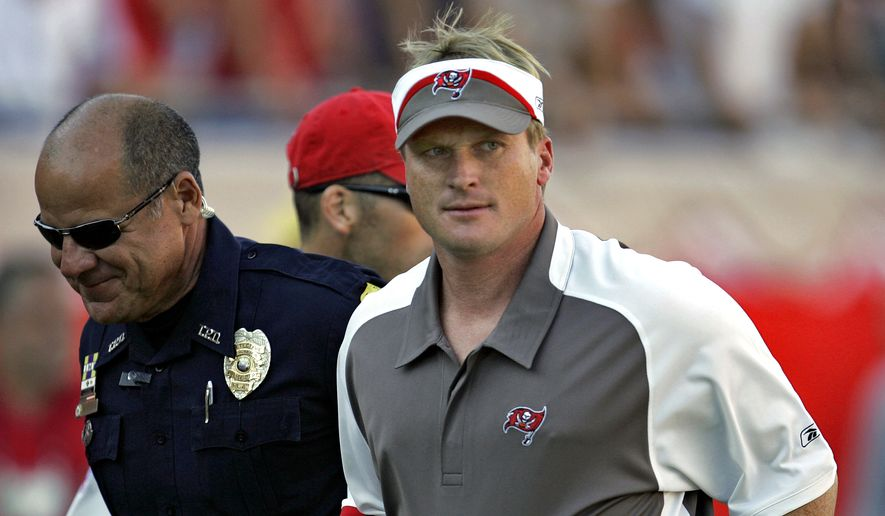 FILE - In this Sunday Nov. 4, 2007 file photo, Tampa Bay Buccaneers head coach Jon Gruden, right, leaves the field after an NFL football game against the Arizona Cardinals  in Tampa, Fla. Jon Gruden says he hopes he's a candidate to return for a second stint as coach of the Oakland Raiders and believes a final decision will be made next week.  Gruden made his most specific comments about the opening in Oakland created when the Raiders fired Jack Del Rio following a disappointing six-win season in an interview Tuesday, Jan. 2, 2018 with the Bay Area News Group. (AP Photo/Chris O'Meara, File)