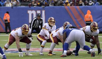 Washington Redskins quarterback Kirk Cousins (8) prepares to take the snap during the first half of an NFL football game against the New York Giants Sunday, Dec. 31, 2017, in East Rutherford, N.J. (AP Photo/Bill Kostroun)