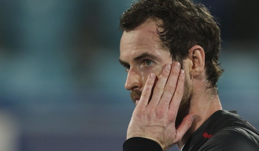 Great Britain's Andy Murray reacts after he lost a match to Spain's Roberto Bautista Agut during the second day of the Mubadala World Tennis Championship in Abu Dhabi, United Arab Emirates, Friday, Dec. 29, 2017. (AP Photo/Kamran Jebreili)