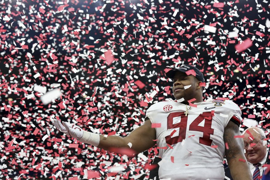Alabama defensive lineman Da'Ron Payne (94) celebrates after being selected most valuable defensive player, after the Sugar Bowl semi-final playoff game against Clemson for the NCAA college football national championship, in New Orleans, Monday, Jan. 1, 2018. Alabama won 24-6 to advance to the national championship game. (AP Photo/Rusty Costanza) **FILE**