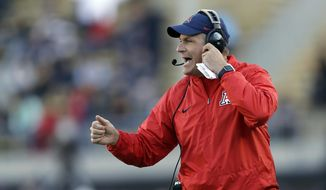 In this Oct. 21, 2017, file photo, Arizona coach Rich Rodriguez yells from the sideline during the first half of the team's NCAA college football game against California in Berkeley, Calif. Arizona has fired Rodriguez after a notice of claim was filed with the state attorney general's office alleging he ran a hostile workplace. The Arizona Daily Star revealed the notice of claim on Tuesday, Jan. 2, 2018, after making a public-records request. Athletic director Dave Heeke issued a statement saying the athletics department decided to go in a new direction after evaluating the program. (AP Photo/Marcio Jose Sanchez, File)