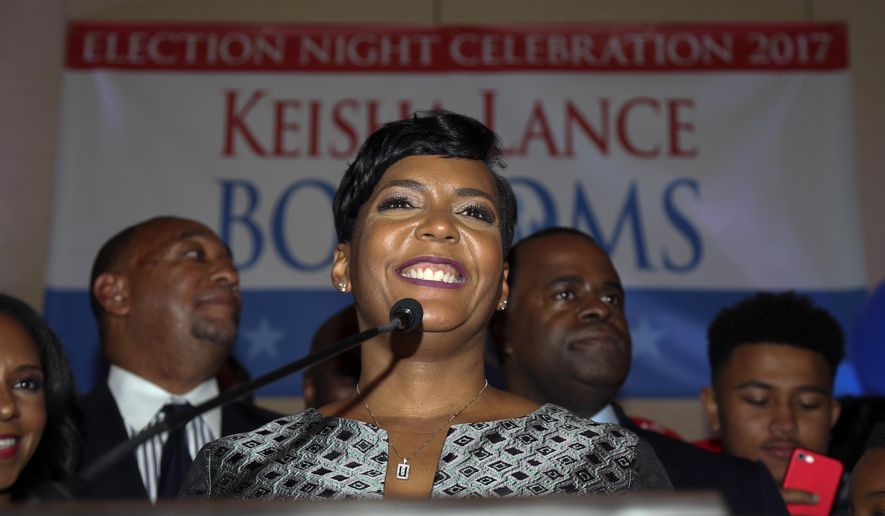 FILE - In this Dec. 6, 2017, file photo, Atlanta mayoral candidate Keisha Lance Bottoms talks during an election-night watch party in Atlanta. Bottoms, Atlanta's new mayor, will be sworn into office during a ceremony at Morehouse College on Tuesday, Jan. 2, 2018. (AP Photo/John Bazemore, File)