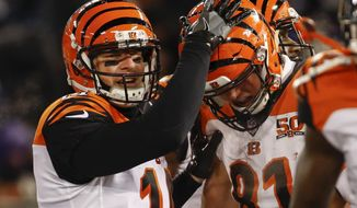 Cincinnati Bengals quarterback Andy Dalton (14) celebrates tight end Tyler Kroft's (81) touchdown reception during the first half of an NFL football game against the Baltimore Ravens in Baltimore, Sunday, Dec 31, 2017. (AP Photo/Patrick Semansky)