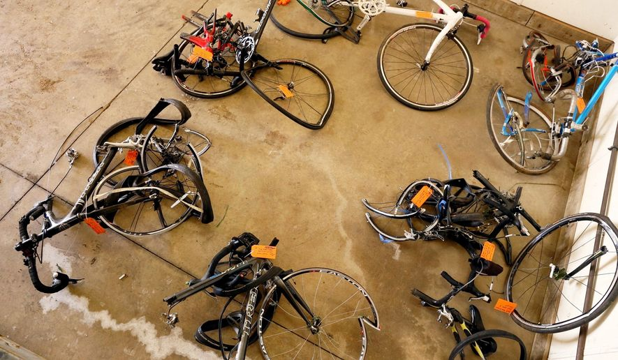 FILE- In this June 9, 2016 file photo, mangled bicycles are tagged as evidence at the Michigan State Police crime lab in Kalamazoo, Mich. A pickup truck plowed into the cyclists on a rural road near Kalamazoo. While other states adopted bike-friendly safety laws to accommodate cycling's soaring popularity, Michigan lawmakers are trying to make up for lost time by seeking some of the nation's strictest bike-safety regulations and tough new penalties for distracted motorists who cause serious injury or death while using a mobile device. (Mark Bugnaski/Kalamazoo Gazette-MLive Media Group via AP, File)