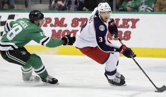 Columbus Blue Jackets defenseman Seth Jones (3) skates with the puck against Dallas Stars center Tyler Pitlick (18) during the first period of an NHL hockey game in Dallas, Tuesday, Jan. 2, 2018. (AP Photo/LM Otero)