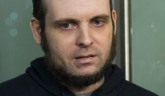 FILE- In this Oct. 31, 2017, file photo, Joshua Boyle speaks to the media after arriving at the Pearson International Airport in Toronto. A lawyer for Boyle, a Canadian man recently freed with his American wife and children after years of being held hostage in Afghanistan, says his client has been arrested and faces at least a dozen charges including sexual assault.Attorney Eric Granger said Tuesday, Jan. 2, 2017, that Boyle also faces assault and forcible confinement charges. (Nathan Denette/The Canadian Press via AP)