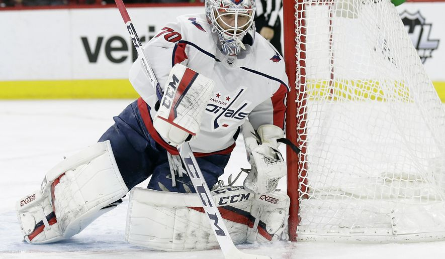 Washington Capitals goalie Braden Holtby deflects a shot during the second period of the team's NHL hockey game against the Carolina Hurricanes in Raleigh, N.C., Tuesday, Jan. 2, 2018. (AP Photo/Gerry Broome)