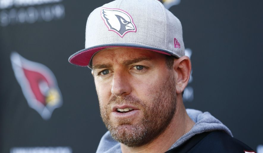 FILE - In this Wednesday, Oct. 11, 2017 file photo, Arizona Cardinals quarterback Carson Palmer answers a question during a news conference after practice at the team facility in Tempe, Ariz. Carson Palmer is retiring after 15 NFL seasons. Palmer, who turned 38 last week, made the announcement in an open letter released by the Cardinals, Tuesday, Jan. 2, 2018.(AP Photo/Ross D. Franklin, File)