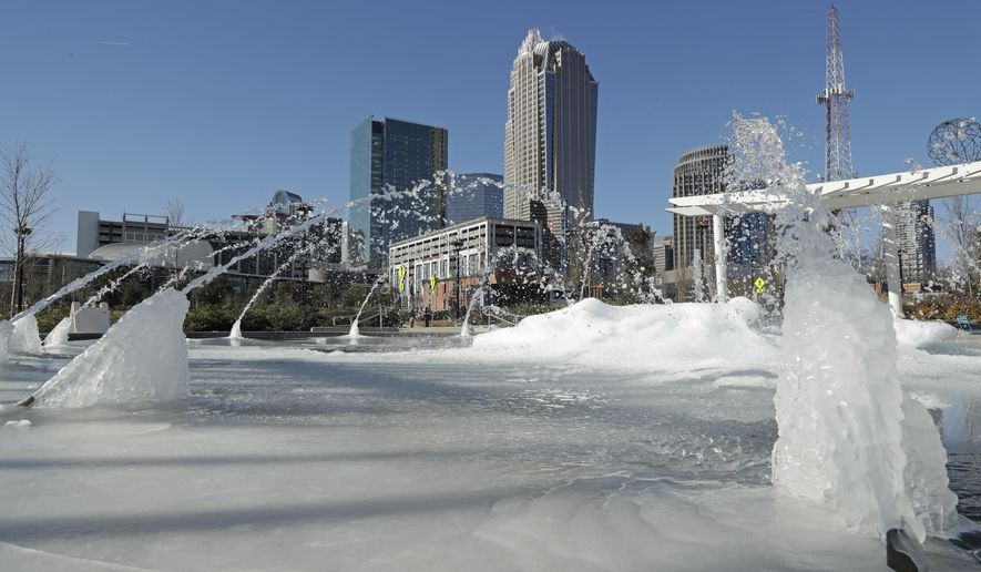 Water squirts from a frozen fountain near downtown in Charlotte, N.C., Tuesday, Jan. 2, 2018. Temperatures plummeted overnight to 2 degrees in the north Georgia mountains, 14 in Atlanta and 26 as far south as New Orleans as the Gulf Coast felt more like Green Bay. (AP Photo/Chuck Burton)
