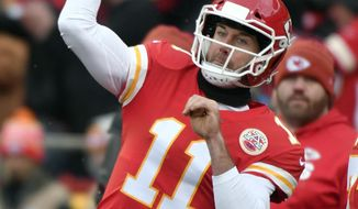 Kansas City Chiefs quarterback Alex Smith (11) warms up before an NFL football game against the Miami Dolphins in Kansas City, Mo., Sunday, Dec. 24, 2017. (AP Photo/Ed Zurga)