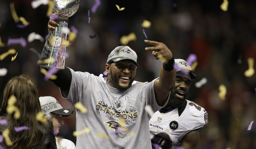FILE - In this Feb. 3, 2013, file photo, Baltimore Ravens linebacker Ray Lewis holds up the Vince Lombardi Trophy as he celebrates with free safety Ed Reed (20) after the Ravens defeating the San Francisco 49ers 34-31 in the NFL football Super Bowl 47 in New Orleans. Star linebackers Lewis and Brian Urlacher are among four first-time eligible former players selected in the 15 modern-era finalists for the Pro Football Hall of Fame's Class of 2018. Receiver Randy Moss and guard Steve Hutchinson also made the cut to the finals as first-year eligibles. (AP Photo/Elaine Thompson, File) **FILE**