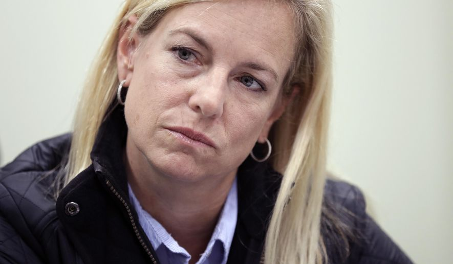 Homeland Secretary Kirstjen Nielsen listens during an interview Tuesday, Jan. 2, 2018, in San Diego. Nielsen told The Associated Press  that the administration doesn't endorse citizenship for recipients of the Deferred Action for Childhood Arrivals program but that it would consider legislation that Congress passes.(AP Photo/Gregory Bull)