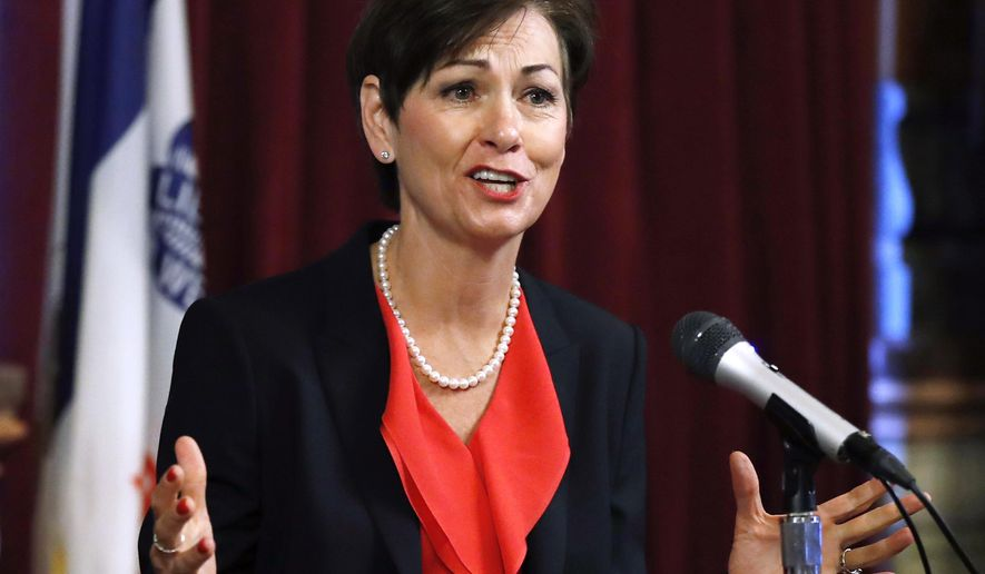 FILE - In this May 25, 2017, file photo, Iowa Gov. Kim Reynolds speaks during a news conference at the Statehouse in Des Moines, Iowa. State Rep. Chris Hall, D-Sioux City, filed a lawsuit Tuesday, Jan. 2, 2018, against Reynolds and Department of Management director Dave Roederer alleging they broke the law when they transferred $13 million from a reserve fund to balance the state budget. (AP Photo/Charlie Neibergall, File)