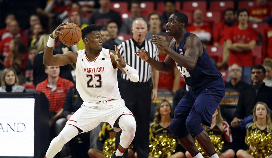 Maryland forward Bruno Fernando, left, of Angola, drives against Penn State forward Mike Watkins in the first half of an NCAA college basketball game in College Park, Md., Tuesday, Jan. 2, 2018. (AP Photo/Patrick Semansky)