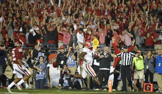 Georgia running back Sony Michel runs for a touchdown during overtime in the Rose Bowl NCAA college football game against Oklahoma, Monday, Jan. 1, 2018, in Pasadena, Calif. Georgia won 54-48. (AP Photo/Mark J. Terrill)