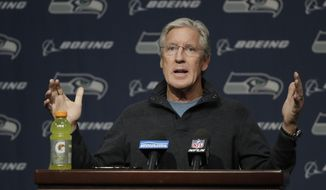 Seattle Seahawks NFL football head coach Pete Carroll talks to reporters, Tuesday, Jan. 2, 2018, during his end-of-season press conference, in Renton, Wash. (AP Photo/Ted S. Warren)