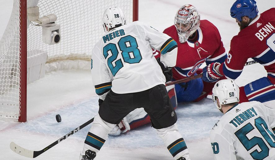 San Jose Sharks' Timo Meier (28) scores against Montreal Canadiens' Carey Price as Canadiens' Jordie Benn (8) and Sharks' Chris Tierney look for the rebound during the second period of an NHL hockey game in Montreal, Tuesday, Jan. 2, 2018. (Graham Hughes/The Canadian Press via AP)