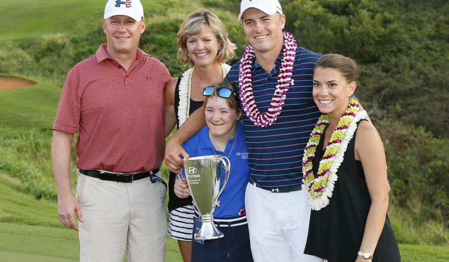 FILE - In this  Sunday, Jan. 10, 2016 file photo, Jordan Spieth poses for a photo with his family, from left, dad Shawn Spieth, mom Mary Christine Spieth, sister Ellie Spieth, front, and girlfriend Annie Verret during the final round of the Tournament of Champions golf tournament at Kapalua Plantation Course on Kapalua, Hawaii.  Spieth confirmed on Tuesday, Jan. 2, 2018 that he is now engaged to Verret. (AP Photo/Matt York, File)