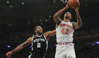 New York Knicks forward Lance Thomas (42) puts up a shot against San Antonio Spurs forward Kawhi Leonard (2) during the second quarter of an NBA basketball game, Tuesday, Jan. 2, 2018, in New York. (AP Photo/Julie Jacobson)