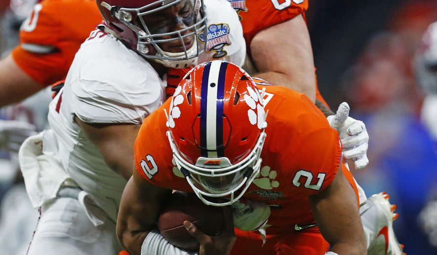 Alabama defensive lineman Raekwon Davis (99) sacks Clemson quarterback Kelly Bryant (2) in the first half of the Sugar Bowl semi-final playoff game for the NCAA college football national championship, in New Orleans, Monday, Jan. 1, 2018. (AP Photo/Butch Dill)