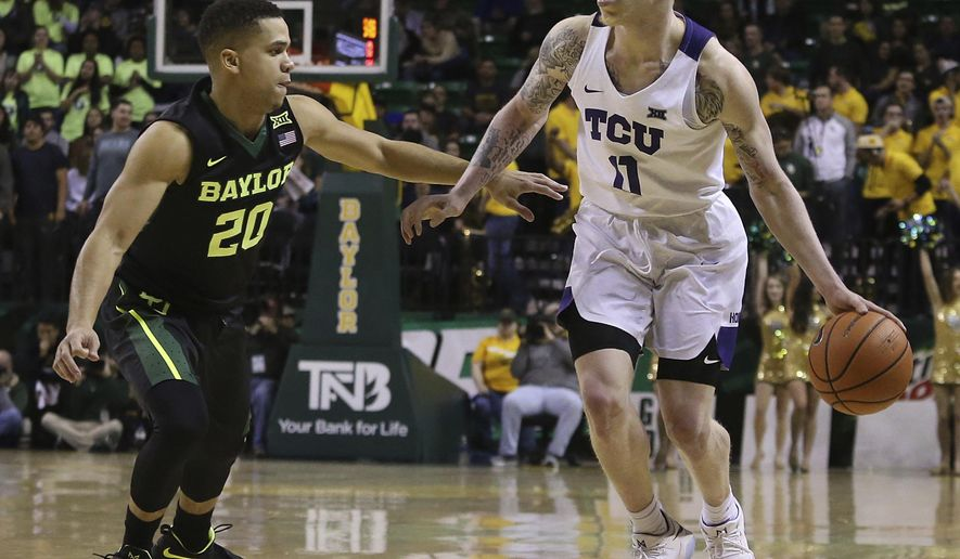 TCU guard Jaylen Fisher (0) is guarded by Baylor guard Manu Lecomte (20) during the first half of an NCAA college basketball game Tuesday, Jan. 2, 2018, in Waco, Texas. (AP Photo/Jerry Larson)