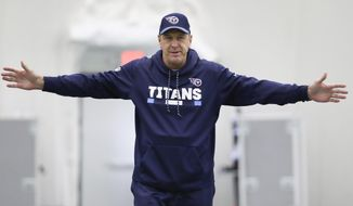 Tennessee Titans head coach Mike Mularkey stretches during an NFL football practice Tuesday, Jan. 2, 2018, in Nashville, Tenn. The Titans are scheduled to play the Kansas City Chiefs Saturday in an AFC wild-card playoff game. (AP Photo/Mark Humphrey)