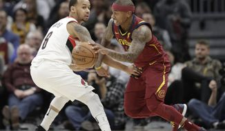 Cleveland Cavaliers' Isaiah Thomas, right, drives past Portland Trail Blazers' Al-Farouq Aminu in the first half of an NBA basketball game, Tuesday, Jan. 2, 2018, in Cleveland. (AP Photo/Tony Dejak)