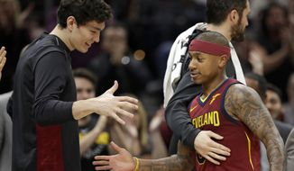 Cleveland Cavaliers' Isaiah Thomas is congratulated by teammates as he walks to the bench in the second half of an NBA basketball game against the Portland Trail Blazers, Tuesday, Jan. 2, 2018, in Cleveland. The Cavaliers won 127-110. (AP Photo/Tony Dejak)