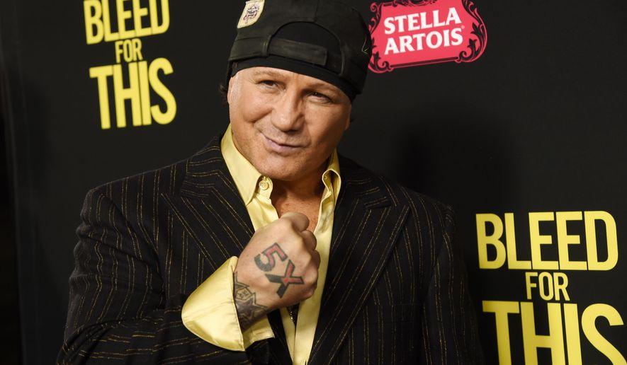 """FILE - In this Nov. 2, 2016, file photo, former boxer Vinny Paz, subject of the film """"Bleed for This,"""" poses at the premiere of the film in Beverly Hills, Calif. Retired boxing champion Vinny Paz, whose comeback story after a car crash was dramatized in the 2016 film """"Bleed for This,"""" has been accused of attacking a Rhode Island man and sending him to the hospital. Providence police say they were called to a home early Tuesday morning, Jan . 2, 2018. They say when officers arrived, witnesses told them Paz had accused a friend of stealing $16,000 and then assaulted him. (Photo by Chris Pizzello/Invision/AP, File)"""
