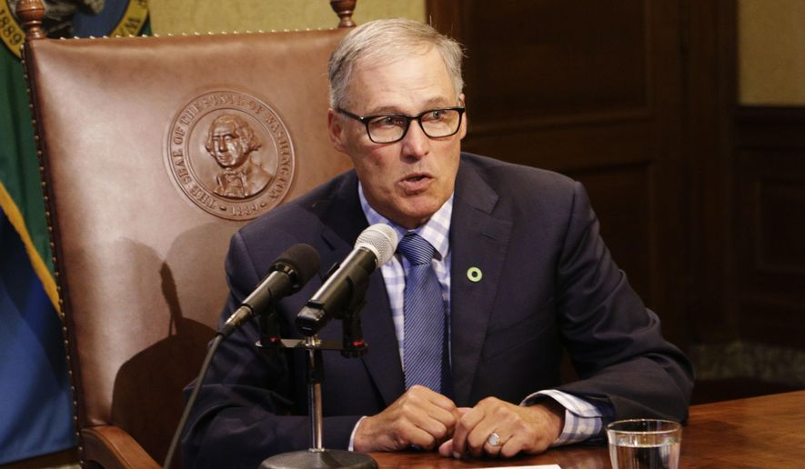 FILE - In this June 27, 2017, file photo, Gov. Jay Inslee talks to reporters about ongoing budget negotiations, in Olympia, Wash. As chairman of the Democratic Governors Association, Inslee will be working to elect governors from his party this year to counteract the Republican dominance in state legislatures. Governors in most states are key to the redistricting process that will follow the 2020 Census. (AP Photo/Rachel La Corte, File)