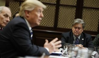 White House Chief Strategist Steve Bannon listens at right as President Donald Trump speaks during a meeting on cyber security in the Roosevelt Room of the White House in Washington, Tuesday, Jan. 31, 2017. (AP Photo/Evan Vucci)