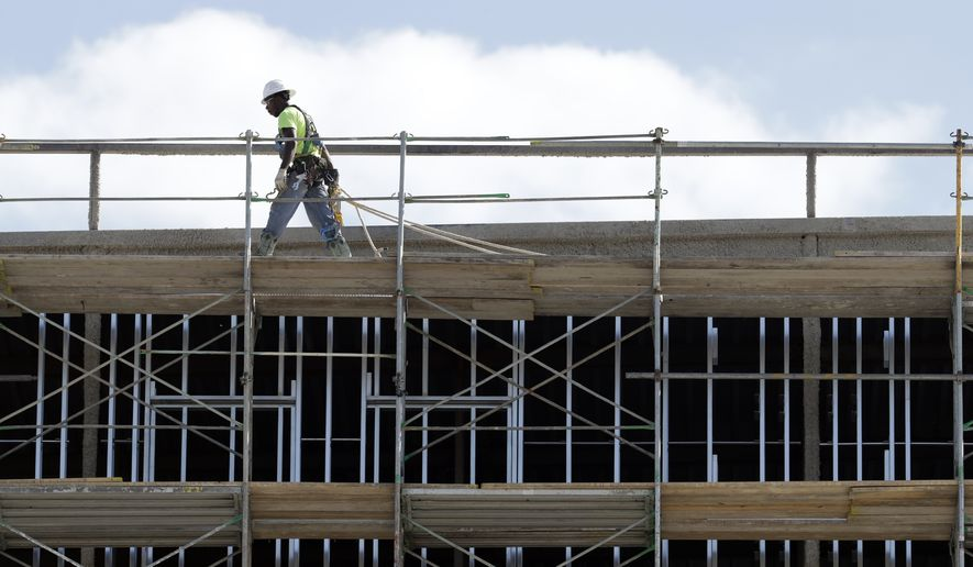 In this Friday, Oct. 6, 2017, file photo, workers build an apartment and retail complex in Nashville, Tenn. On Wednesday, Jan. 3, 2018, the Commerce Department reports on U.S. construction spending in November. (AP Photo/Mark Humphrey) ** FILE **