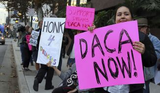 In this file photo, demonstrators urging the Democratic Party to protect the Deferred Action for Childhood Arrivals Act (DACA) rally outside the office of California Democratic Sen. Dianne Feinstein in Los Angeles Wednesday, Jan. 3, 2018. (AP Photo/Reed Saxon)