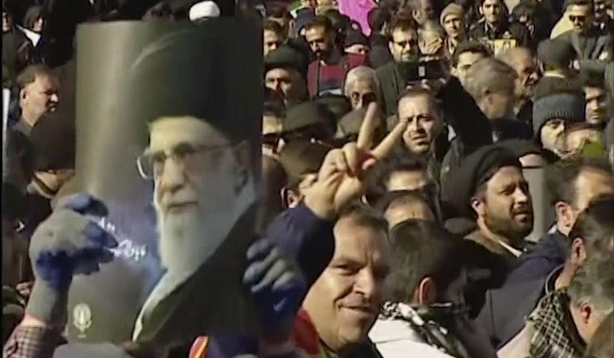 This frame grab from video provided by Iran Press, a pro-government news agency based in Beirut, shows pro-government demonstrators marching in, Arak, Iran, Wednesday, Jan. 3, 2018. Tens of thousands of Iranians took part in pro-government demonstrations in several cities across the country on Wednesday, Iranian state media reported, a move apparently seeking to calm nerves after a week of protests and unrest that have killed at least 21 people.(Iran Press via AP)