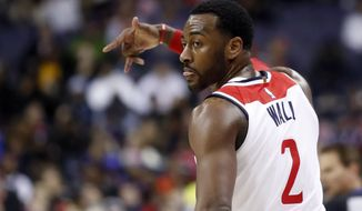 Washington Wizards guard John Wall reacts after a 3-point shot during the second half of the team's NBA basketball game against the New York Knicks, Wednesday, Jan. 3, 2018, in Washington. The Wizards won 121-103. (AP Photo/Alex Brandon) ** FILE **