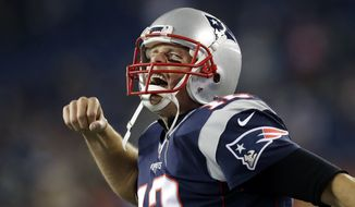 New England Patriots quarterback Tom Brady yells as he takes to the field before an NFL football game against the Seattle Seahawks, Sunday, Nov. 13, 2016, in Foxborough, Mass. (AP Photo/Charles Krupa)